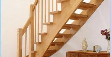 Largueros de escaleras con las manos